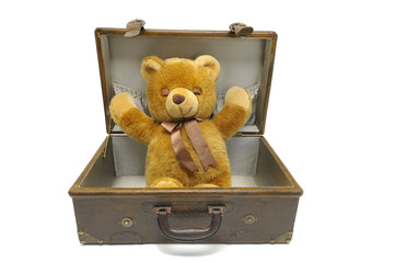 Old case with teddy bear