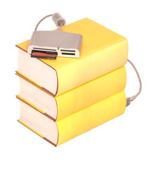 Pile of yellow hardback books with a compact flash card reader