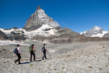 group of hikers heading towards Matterhorn