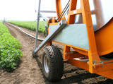 Irrigation installation (watering machine) in the field poster