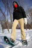 Young woman hiking with Snow shoes / Rackets poster