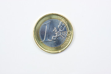 One euro coin closeup on white background