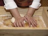 Amasando el pan con el talon de las manos poster