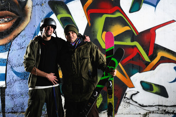 two skiirs standing against colorful background