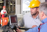 supervisor talking to engineer in warehouse poster