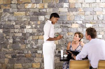 Waitress taking customerճ order in restaurant