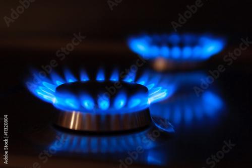 Leinwanddruck Bild Erdgas Flammen mit Spiegelung