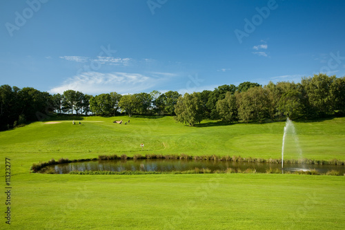 Open golf landscape with a pond in Molle, Sweden