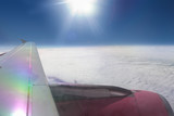 Aerial view of airplane wing and cloudy sky