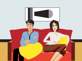 Couple sitting on sofa, looking angry