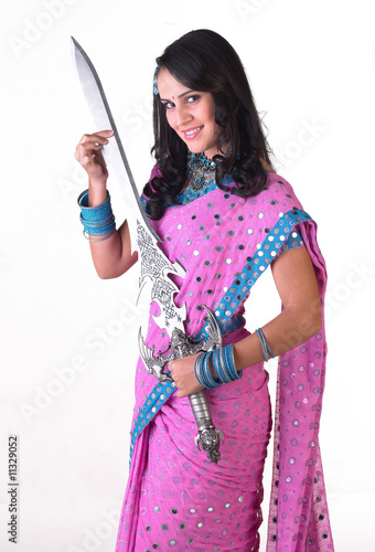 Asian girl holding big sword