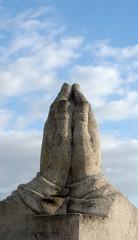 Praying Hands Statue To Blue Sky
