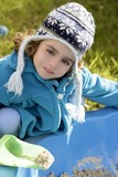 beautiful toddler girl winter hat portrait outdoors