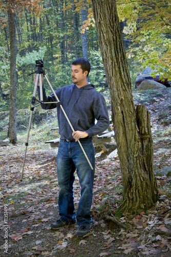 Man setting up for nature photography shot