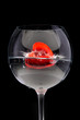 red jelly heart in wine glass on black background