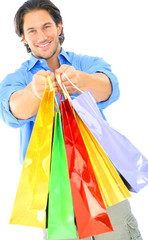 Attractive Young Man Offering Shopping Bags