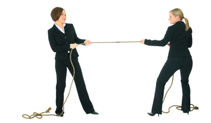 two businesswomen pulling rope with each another