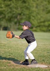 Little Boy Playing First Base