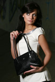 brown haired pretty woman with handbag