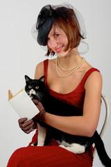 lettura gatto sedia maliziosa