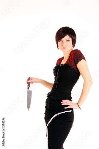 Girl in the black-red suite with the knife, isolated on white
