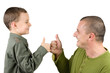 father and son showing ok sign