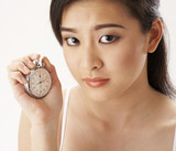 young woman holding a stop watch