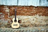 Fototapety Spanish guitar on old wall, copy spaced.