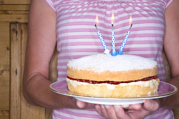 Close up of woman holding cake
