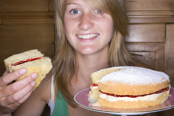 Close up of girl holding cake