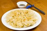 Plate Full of Fried Chinese Dumplings poster