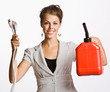 Businesswoman holding electrical plugs and gas can