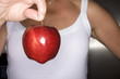 Close up of woman holding red apple