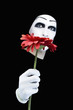 Portrait of the mime with a red flower