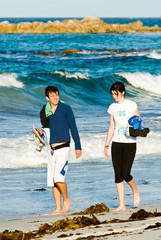 Attractive Young Couple Walking Beach Waves