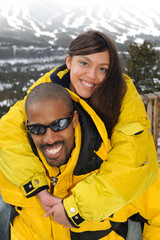 African American Father and Daughter Vacationing at Ski Resort