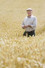 Farmer standing field