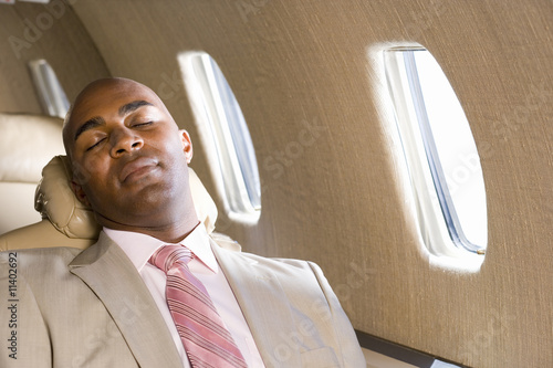 Man asleep on aeroplane, close-up