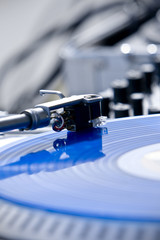 Turntable with Blue Scratch Vinyl Record