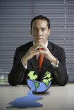 Business man concerned with earth poster
