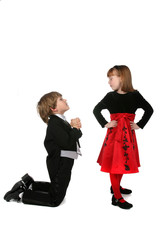 children in formal clothing mimicing adult proposal behavior