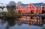 Stavangher tradicional houses and reflex in city lake (Norway) poster