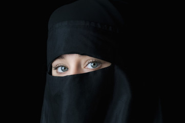 Beautiful blue eyed woman in traditional Middle Eastern veil