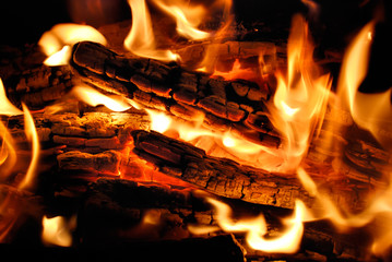 The wood burns on fire