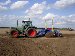 ploughing the land with big agri culture machine