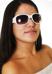 Beautiful young woman wearing white sunglasses