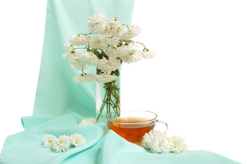 Glass tea cup and flowers