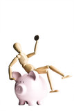 Manikin holding a coin, sitting on a piggy bank poster