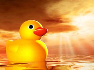 Rubber duckling in evening sunshine on the sea