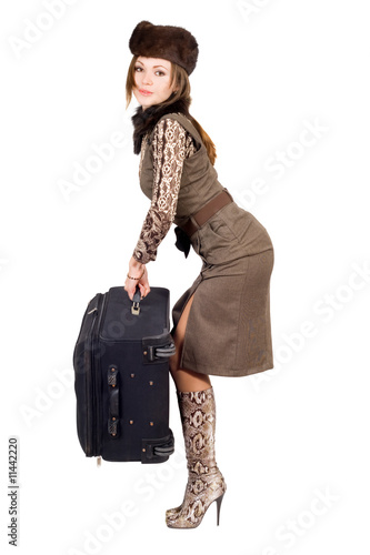Young woman with a suitcase. Isolated on white